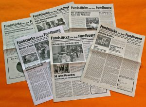 6 editions of the newspaper Fundstuecke aus dem Fundbuero on a bright orange background