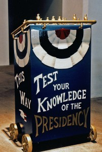 "Whistle Stop Stumping Podium, view from front with the text ""Test your Knowledge of the Presidency"""
