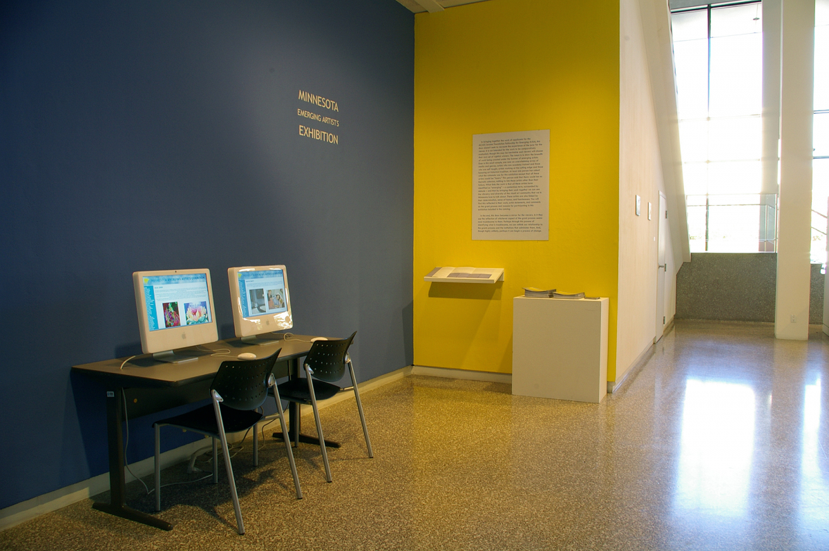 Installation view of HTML archive and exhibition statement and brochures
