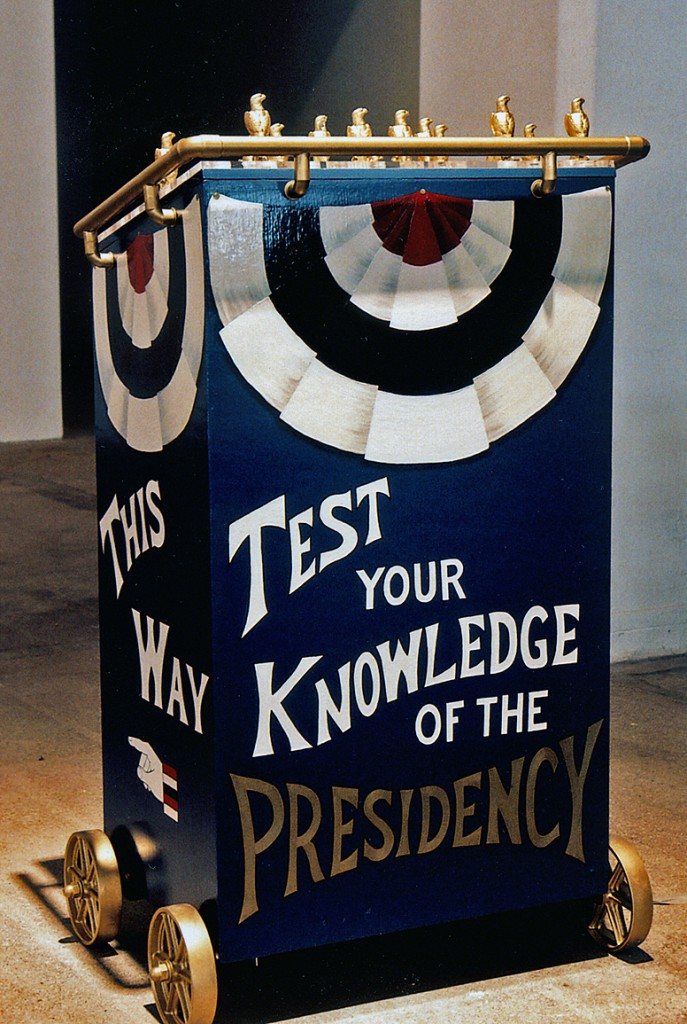 """Whistle Stop Stumping Podium, view from front with the text """"Test your Knowledge of the Presidency"""""""